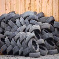 Waste tire rubber crumbs for road and pavement construction