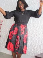 black top on flowery satin skirt