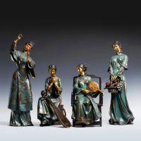 A set of four stylized modern bronze statues of me, a bronze statue of a Chinese woman,