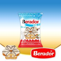 Berador milky white compound chocolate and coconut coated cake with milk sauce