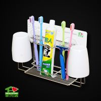 Wall mounted adhesive toothbrush