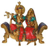 Brass Lord Radha Krishna Sitting On a Sofa Set with Turquoise Work Handcraft Statue