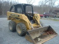 John Deere Skid Steer with attachments