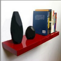 red floating shelf with bracket