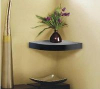 white floating corner shelf
