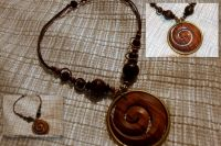 Necklace with wooden beads and large wood and brass pendant