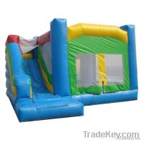 blue and green inflatable bouncer house & slide