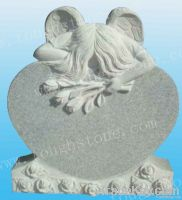 Tombstone with Angel and Flower Carving