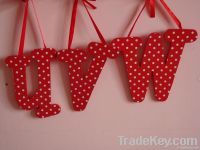 wooden letters with ribbon