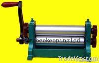 Beeswax stamping machine