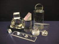 Lenses, prisms, mirrors, tubes, plates, windows, fiber optics