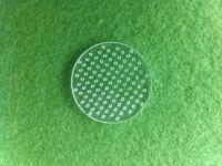 Laser perforated quartz glass plate