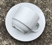 Ceramic white coffee cup and saucer with golden box packing