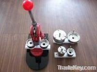 Badge making machine