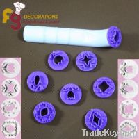 Embossing roll cutter