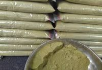 Kratom powder and crushed leaves