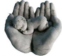 Baby in hands sculpture
