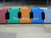 Dog-bone shape rubber tiles