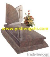brown stone monument with plastic flower