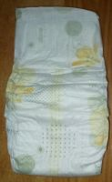 Disposable Baby Diapers with re-fastenable tapes