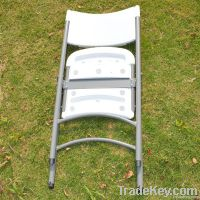 white plastic folding chair for indoor or outdoor
