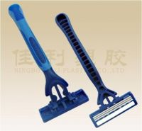 three stainless steel blade razor