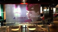 Rear projection film screens for shop windows by V-Studio