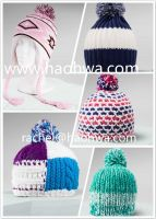 Winter knitted acrylic hat with pompoms