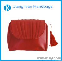 red luxurious makeup bag with tassel