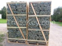 DRIED FIREWOOD LOGS AND KINDLINGS ON PALLET BOXES ( CRATES ) , IN MESH BAGS.
