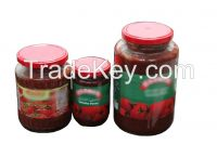 canned tomato paste in glass jar