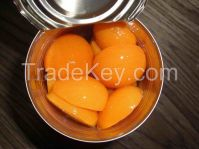 Canned apricot halves in tins and glass jars