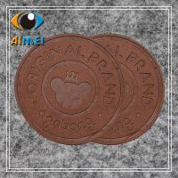 Customized round PU leather labels handmade brand logo stitched tags custom embossed name sew Leather Garment tag for clothing