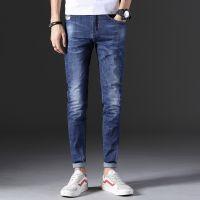 Man's fashionable dark blue ripped slim fit denim jeans