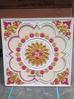 Colourized gypsum tile