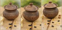 Ceramic pot with lid made of red clay.
