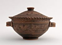 Ceramic bowl with handles and lid made of red clay.