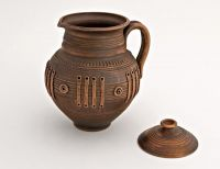 Ceramic jar with lid made of red clay.