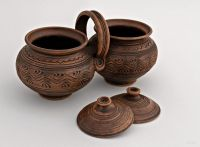 Ceramic pot set of two pots made of red clay.