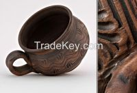 Ceramic tea cup, hand formed and made out of red clay.