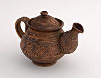 Ceramic tea pot made of red clay.
