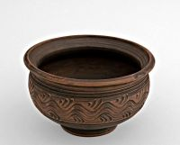Ceramic clay bowl made of red clay.