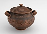 Big brown ceramic pot with lid made of red clay.
