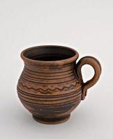 Handmade decorative coffee mug made of red clay.