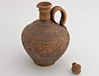 Clay jug with lid.