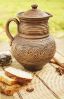 Clay jug, jar, pitcher with a lid.