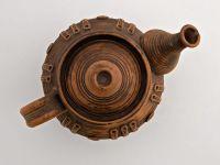 Handmade ceramic tea pot made of red clay.