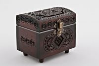 Wooden jewelry box with hand carved pattern.