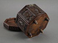 Original carved wooden octahedral box.