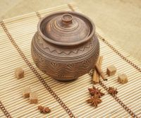 Ceramic roasting pot with a lid made by hands.